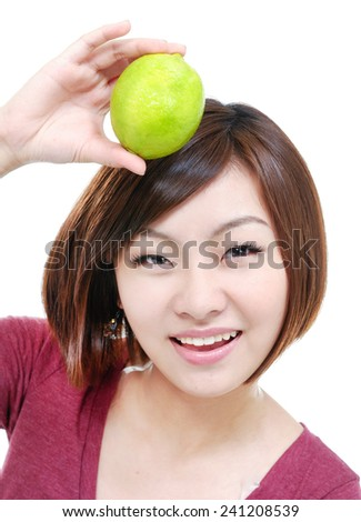 young pretty woman showing limes - stock photo