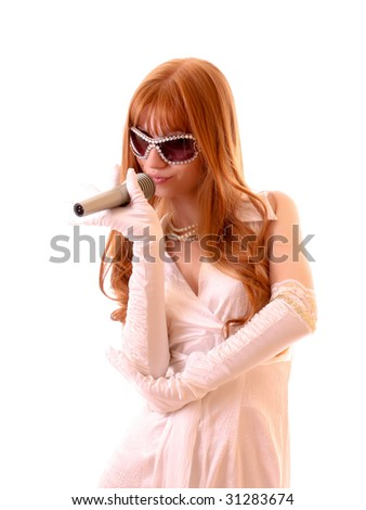 Young pretty woman singing with microphone isolated - stock photo