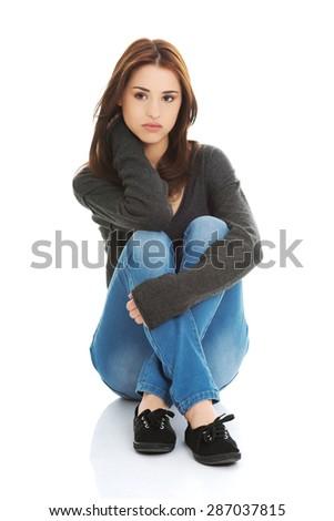 Young pretty woman sitting legged - stock photo
