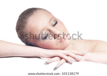 Young pretty woman sleeping on hands isolated on white background