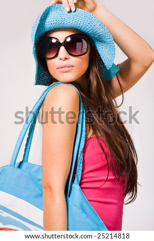 young pretty woman summer portrait in pink dress, sunglasses and hat - stock photo