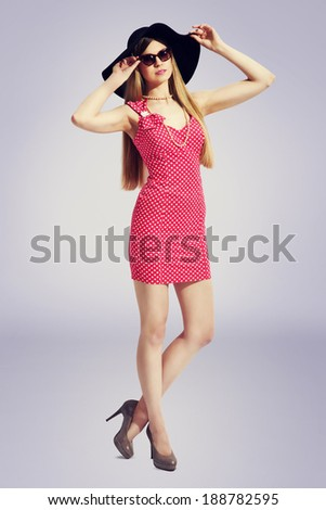 young pretty woman summer portrait in pink dress, sunglasses high heels and hat  - stock photo