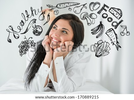 Young pretty woman thinking of healthy food closeup face portrait and sketches overhead - stock photo