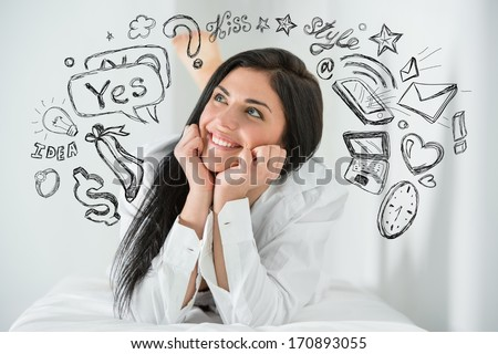 Young pretty woman thinking of her plans closeup face portrait and sketches overhead - stock photo