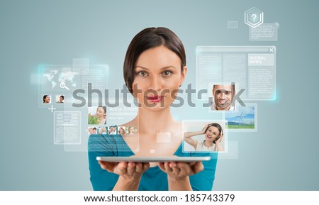 Young pretty woman using social media on her tablet computer - stock photo