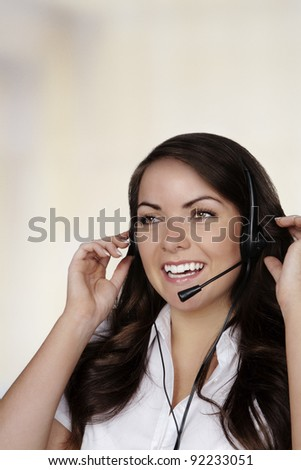 young pretty woman wearing a headset talking to someone - stock photo