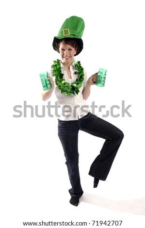 Young pretty woman wearing green hat celebrates St Patrick's day.