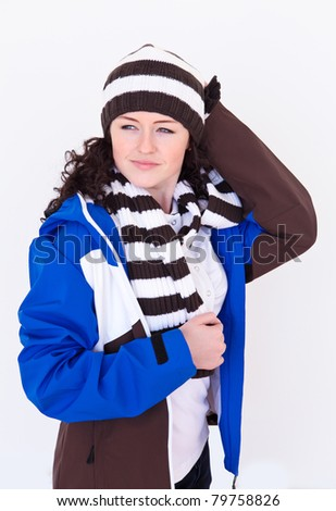 young pretty woman wearing winter hat and scarf