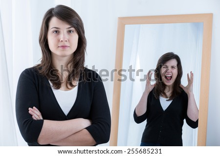 Young pretty woman with anger inside her - stock photo