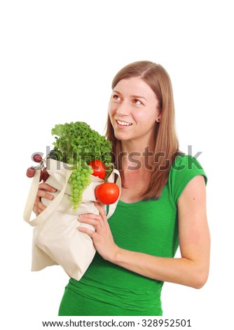 Young pretty woman with bag of fresh vegetables - stock photo