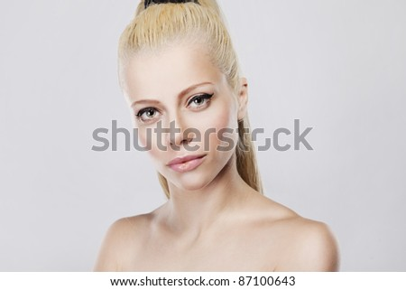 Young pretty woman with beautiful blond hairs on white background