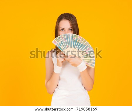 Young pretty woman with fan, studio