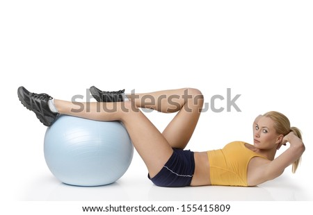 young pretty woman with gym body , doing stretching exercise with ball isolated on white looking in camera - stock photo