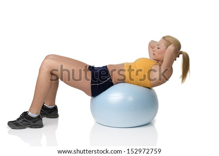 young pretty woman with gym body , on big ball doing fitness exercise . Natural skin - stock photo