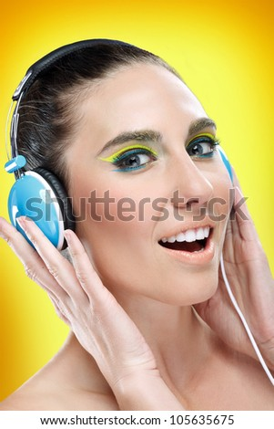Young pretty woman with headphones singing