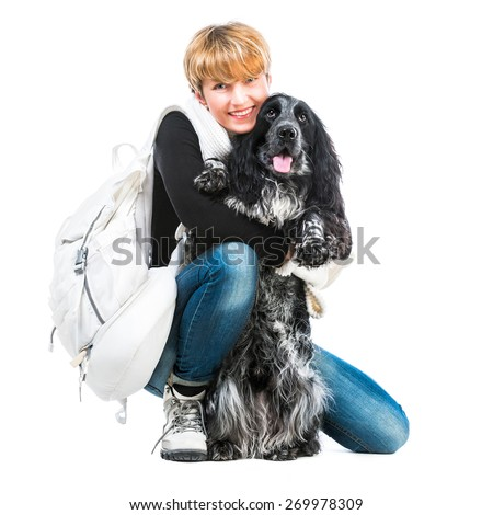 young pretty woman with her dog cocker spaniel in a studio isolated on a white background - stock photo