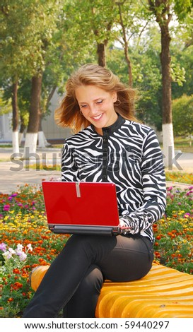 young pretty woman with laptop - stock photo