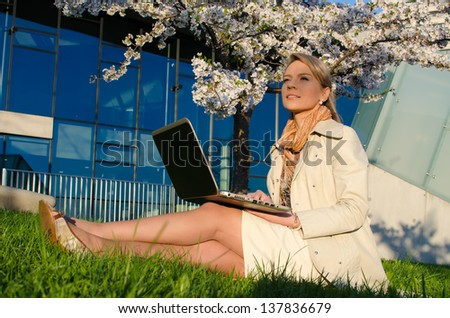 Young pretty woman with laptop in Vilnius, Lithuania - stock photo