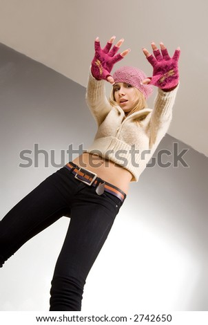 Young pretty woman with rose gloves