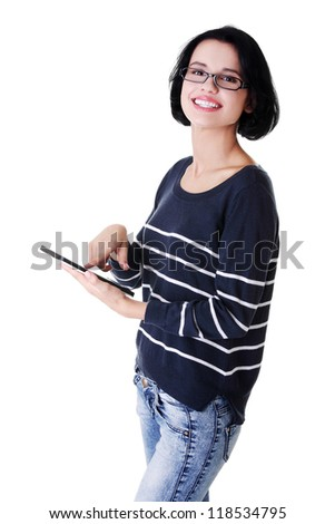 Young pretty woman working on tablet computer, isolated on white - stock photo