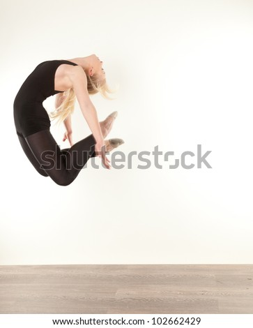 young pretty women jumping - stock photo