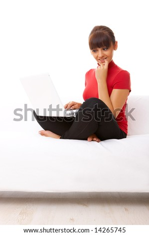 Young pretty women on white couch relaxing and using laptop computer