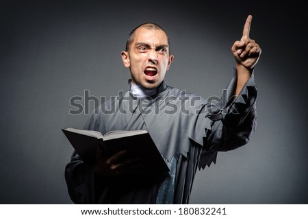 Young priest isolated on the white - stock photo