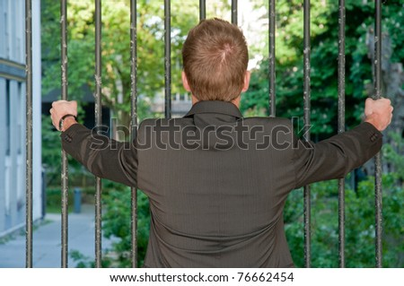 Young prisoner business man - stock photo