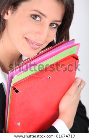 Young professional holder folders - stock photo