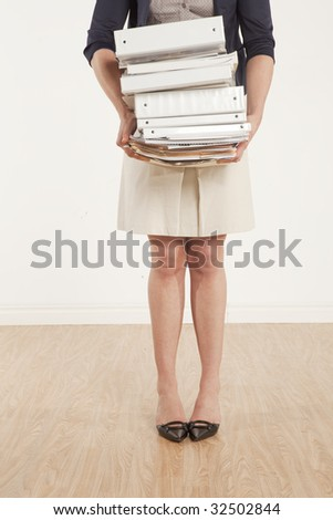 young professional holding stack of work - stock photo