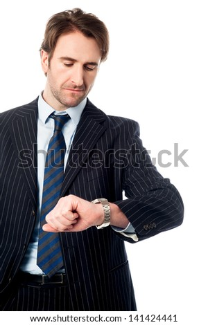 Young professional looking at his watch - stock photo