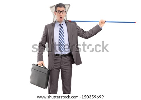 Young professional man in suit caught in a fishing net isolated on white background - stock photo