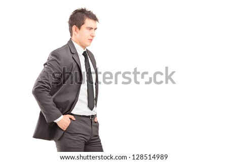Young professional man with hands in pockets shot during an argue isolated on white background - stock photo