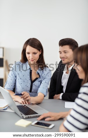 Young Professional People Using a Laptop Computer for Presentation While Having a Business Meeting Inside the Office.