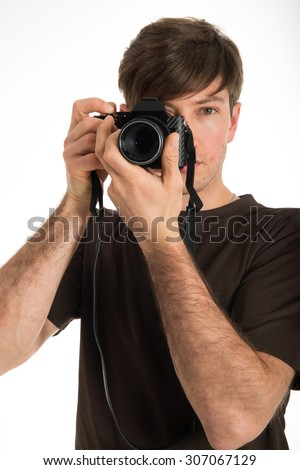 Young professional photographer shooting in the studio