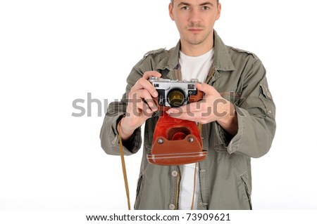 Young professional photographer with old retro film camera. isolated on white background