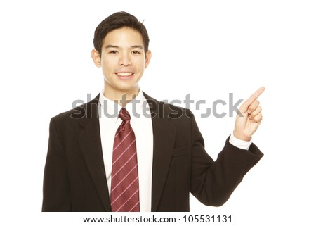 Young professional pointing and presenting - stock photo