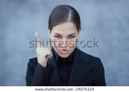 Young professional, pointing with her finger, looking upset