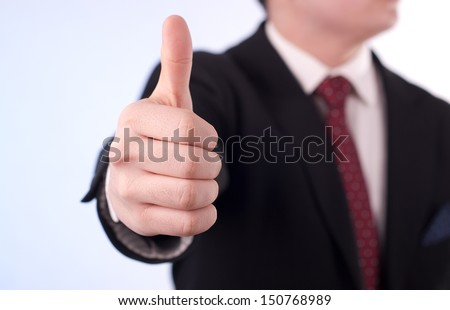 Young professional shows fingers arranged in O'K sign - stock photo