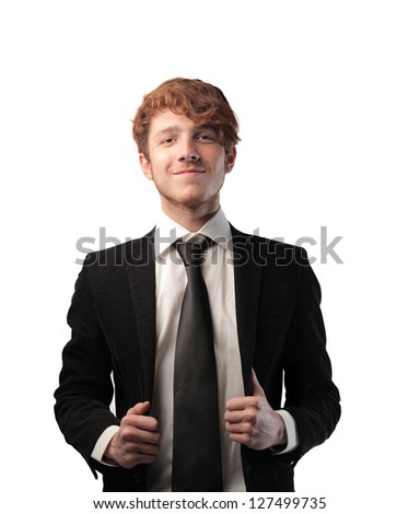 young proud businessman on white backgorund - stock photo