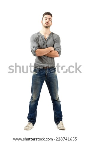 Young proud satisfied man with crossed arms looking at camera. Full body length isolated over white background. - stock photo