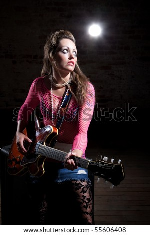 Young punk rocker tunes waits for cue to tune her guitar