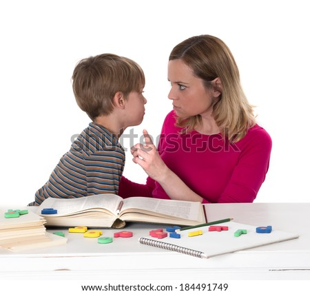 young pupil doesn't want to learn, he confronts his mother who is threatening him - stock photo