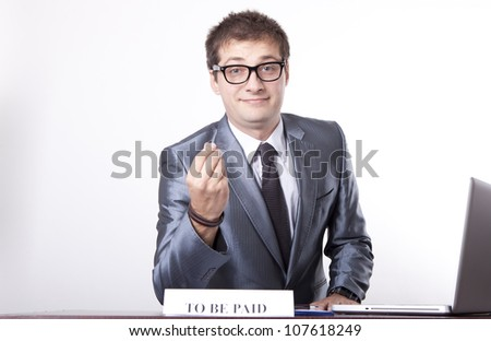 Young receptionist at to be paid desk. - stock photo