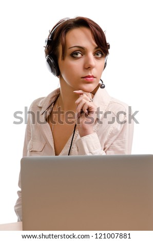 Young receptionist or call centre operator sitting at her desk behind a laptop computer waiting for the next call to come in