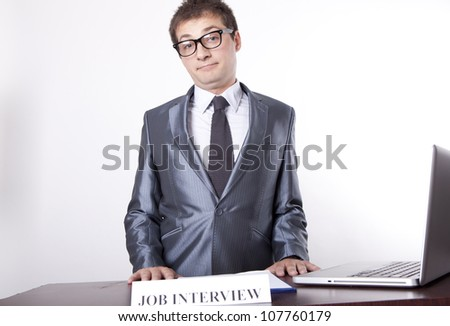 Young receptionist showing direction to job interview. - stock photo