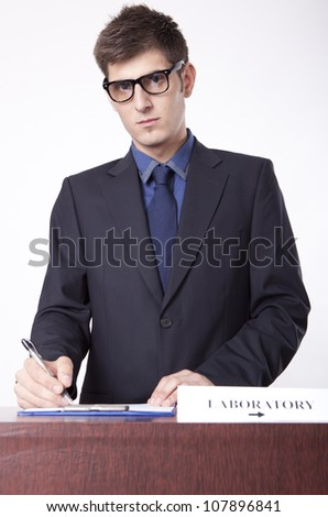 Young receptionist showing direction to laboratory. - stock photo