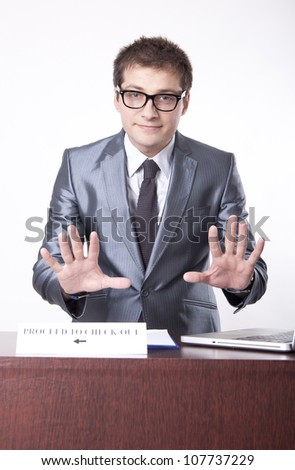 Young receptionist showing direction to proceed to check out. - stock photo