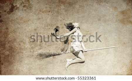 Young red-haired witch on broom flying in the sky. Photo in old image style. - stock photo