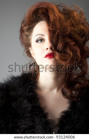 young red-haired woman with red lips
